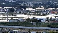 展示予定写真の一つ。堤防決壊で浸水した長野市穂保地区=昨年10月13日