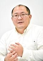 インタビューに答える京都大の西浦博教授