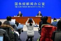中国のGDP速報値を発表する国家統計局の記者会見=18日、北京(共同)