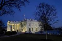 米ホワイトハウス=23日、ワシントン(AP=共同)