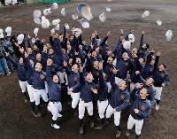 選抜高校野球大会への初出場が決まり、帽子を投げて喜ぶ大崎の選手たち=29日午後、長崎県西海市
