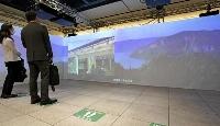JR東京駅で開かれた、東北地方の景観や伝統文化をVR映像で紹介するイベント=24日午前
