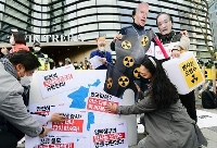 ソウルの日本大使館前で開かれた、東京電力福島第1原発処理水の海洋放出決定に抗議する集会=15日(共同)