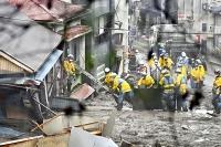 大規模な土石流が発生した現場で、建物を捜索する警察官ら=4日午後2時25分、静岡県熱海市伊豆山