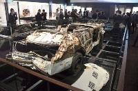 展示されている、津波で流されたパトカー=11日午前、福島県富岡町