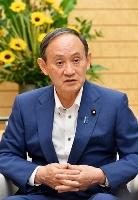 共同通信社の単独インタビューに応じる菅首相