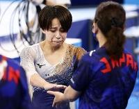 女子団体総合決勝 平均台の演技を終え涙ぐむ村上茉愛=有明体操競技場