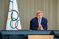 オンライン形式の理事会に出席したIOCのバッハ会長=8日、スイス・ローザンヌ(IOC提供・ロイター=共同)