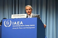 20日、ウィーンでの国際原子力機関(IAEA)年次総会で演説するグロッシ事務局長(共同)
