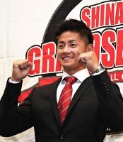 ヤクルトから育成1位で指名され、笑顔を見せる信濃の岩田幸宏