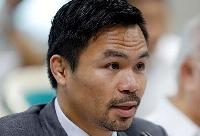 フィリピン上院で発言するパッキャオ氏=2017年5月、マニラ(ロイター=共同)