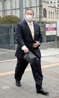 スーツ姿で日本相撲協会の研修会に出席した元横綱白鵬の間垣親方=16日午後、両国国技館