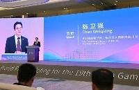 18日、杭州アジア大会のメディア向け説明会であいさつする中国浙江省杭州市の陳衛強副市長(共同)