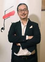 「第18回ショパン国際ピアノ・コンクール」本選での演奏直後に取材に応じた反田恭平さん=18日、ワルシャワ(共同)