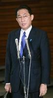 国家安全保障会議を終え、記者団の取材に応じる岸田首相=19日午後、首相官邸